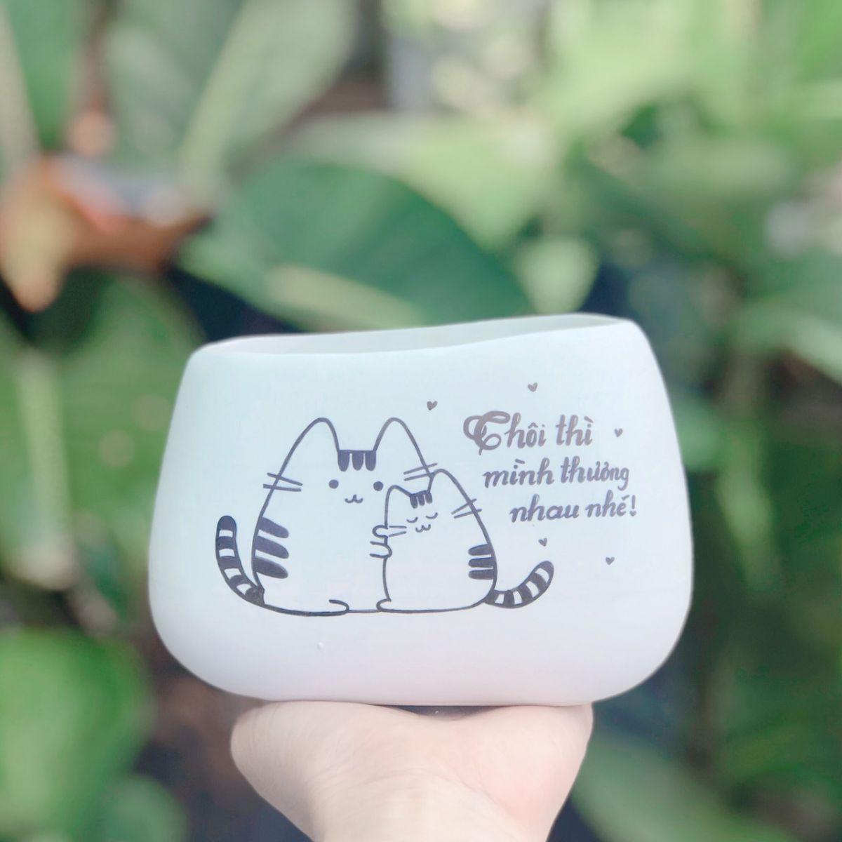 Chậu sứ men mát dáng méo hồng 8*8-11cm vẽ mèo